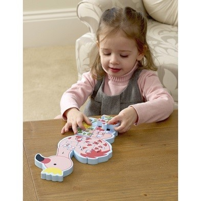 flamingo number puzzle by orange tree toys with girl