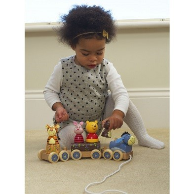 winnie the pooh puzzle train by orange tree toys with girl