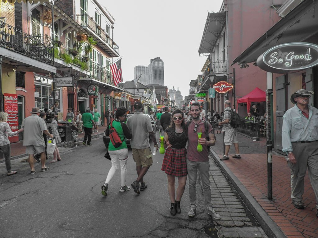 Couple with Hand Grenades cocktails on Bourbon Street