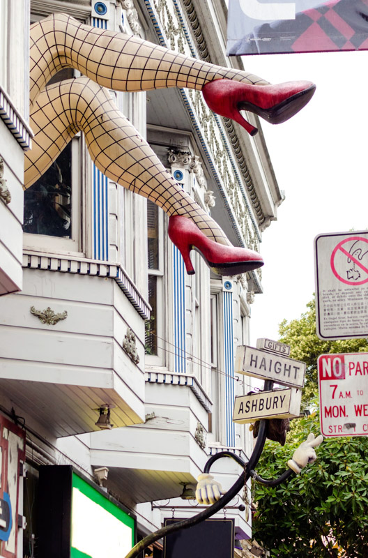 Legs with fishnets and red shoes sign in San Francisco Castro District
