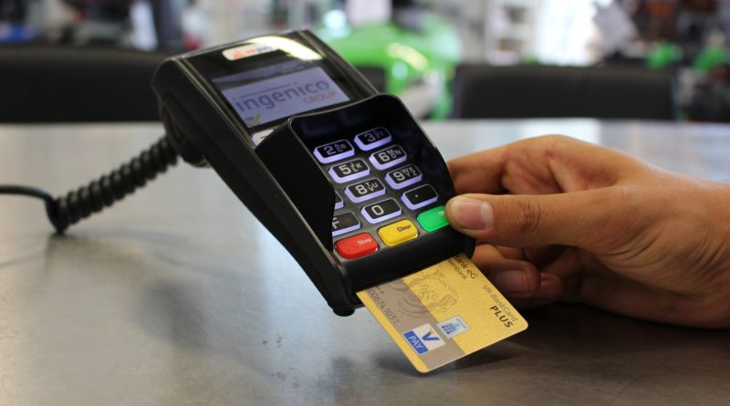 person paying by card - millennials living on a budget