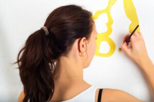 woman-painting-a-room-home-diy