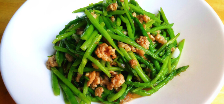 cooked pork and asparagus on plate