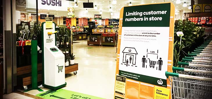 Notice-board-and-floor-sticker-at-Woolworths-supermarket