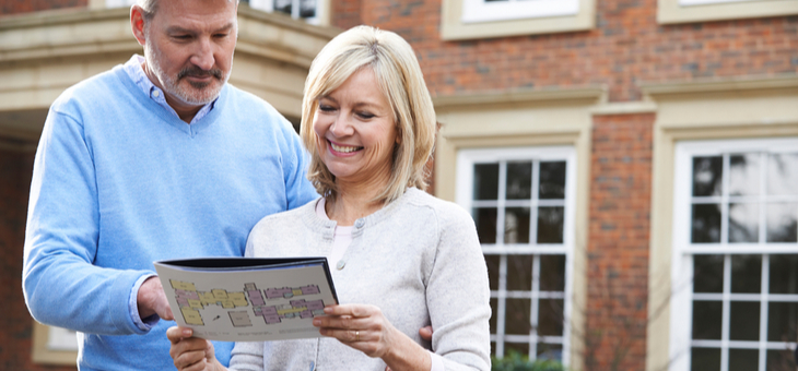 mature-couple-buying-home