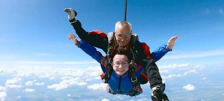 happy couple tandem skydiving