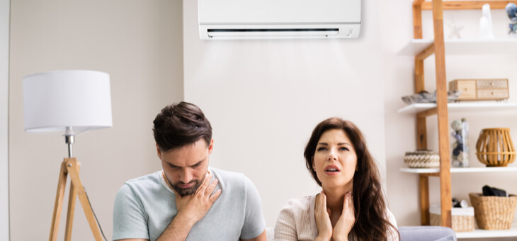 couple struggling with air con
