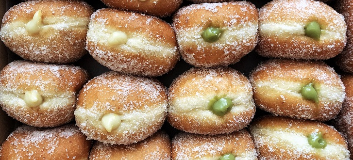 rows of cream filled donuts