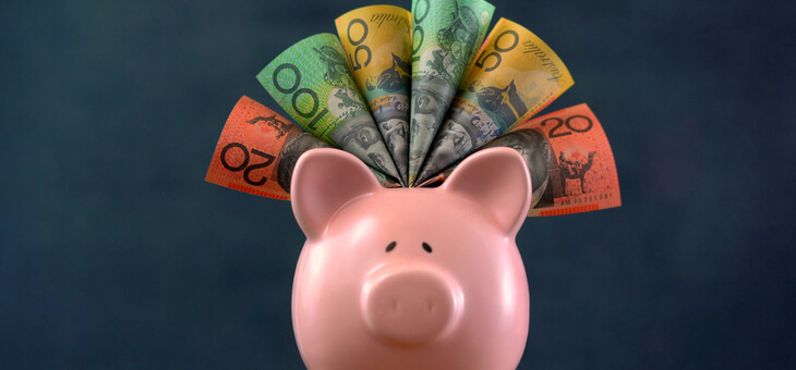 piggy bank with australian bank notes sticking out