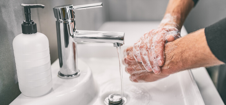 male hands at sink being washed
