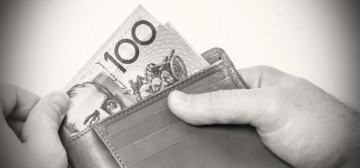 Man holding wallet with Australian money black and white