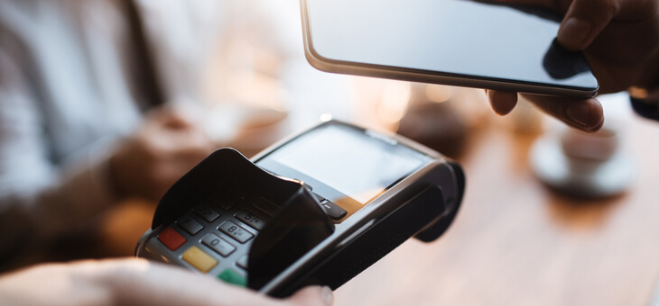 person paying for good with smartphone