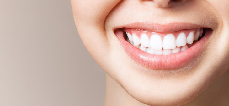woman's smiling mouth showing white teeth
