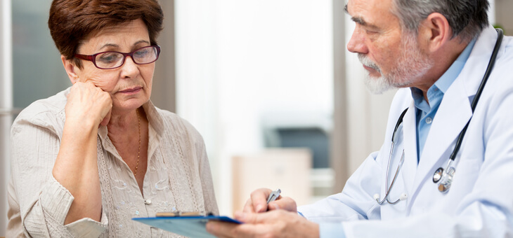 frustrated woman speaking with doctor