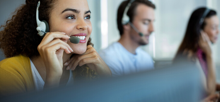 woman in call centre speaking on headset