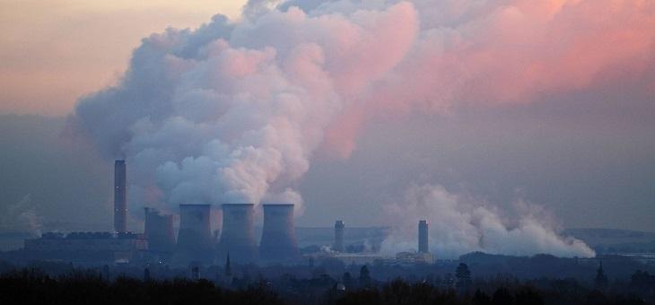 smoke billowing from industrial chimneys