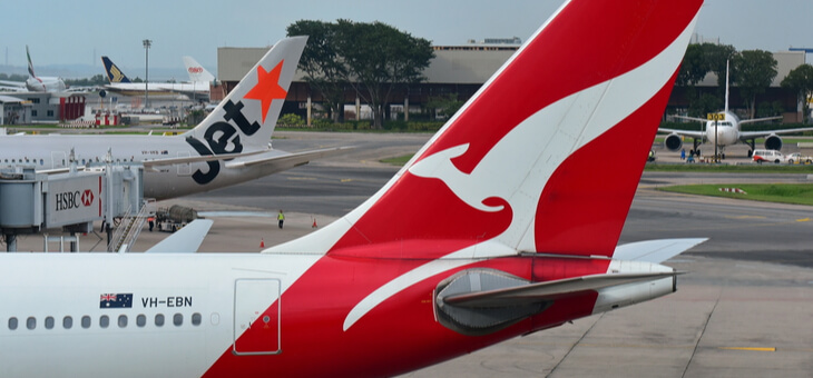 tails of a qantas and a jetstar plane