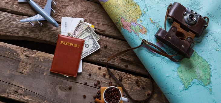 passport, map and glasses on table
